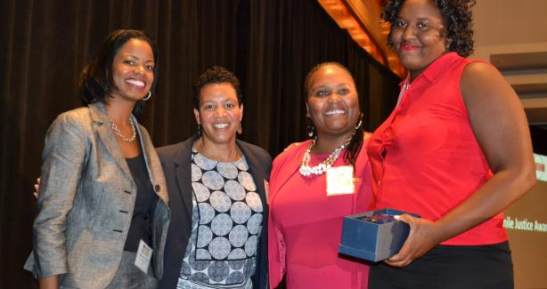 Dashona Bland is presented with the 2017 Youth on the Rise Award
