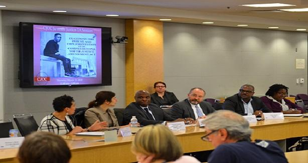 Attendees and panelists at the training session sitting at a conference table