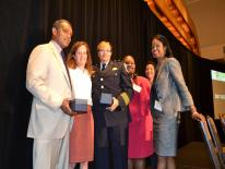Attorney General Karl Racine, Dr. Hilary Cairns, and Assistant Chief Kimberly Chisley-Missouri are presented with the 2017 Outstanding Collaboration Award